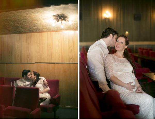 Brautpaar küsst sich in der letzten Reihe im Kino