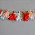 DIY – Mini-Quastengirlande für die Hochzeitstorte
